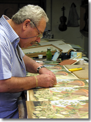 Giuseppe Rocco works on his intarsia marquetery.