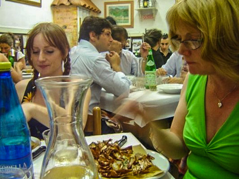 TheDiners enjoying carciofi alla giudia (fried artichokes) at Sora Margherita in Rome