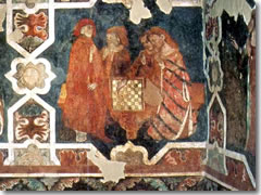 A medeival fresco of nobles playing chess in the Castello di Arco
