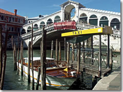 A taxi acquei (water taxi) stand near the Rialto Bridge in Venice
