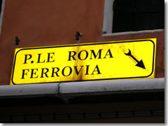 Yellow directional signs in Venice